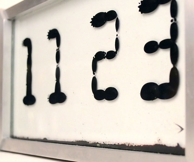 Ferrofluid Clock Interwebs